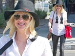 Anna Faris took her beaming happiness to the streets of Los Angeles in a stylish and androgynous black-and-white ensemble on June 24