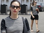 Pale and interesting: Emmy Rossum highlights her porcelain complexion with a monochrome outfit as she steps out in Beverly Hills