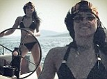 She knows how to take charge! Michelle Rodriguez wears tiny bikini as she gets behind the wheel of sailboat
