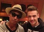 Exciting times: Pharrell Williams revealed he's been hanging out at the studio with One Direction star Liam Payne (right) ...and says he'd be up for a collaboration with the band