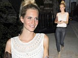 Did you spray those on? Poppy Delevingne's long pins are impossible to miss in shiny navy skinnies on night out at Chiltern Firehouse