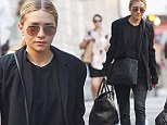 Just another 9-to-5'er? Millionaire Ashley Olsen schlepps TWO cram-packed purses down a trash bag-lined NYC street on way to design job