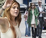 You can sit with me: Lindsay Lohan steps out in knee high black boots and socks to dine with mystery man in Mayfair