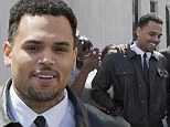 Chris Brown smiles as he leaves court after rejecting plea deal in Washington DC assault case... will now have to face trial
