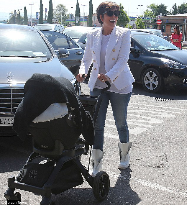 ...But she really can't complain too much: Kris often takes care of Kim's daughter North, who will turn one on Sunday; here the matriarch is pictured with the child on May 25, the day after the Kimye nuptials