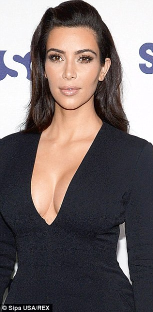 Cleavage runs in the family?: Kris in a plunging white dress at Kim's wedding in May; Mrs West in a plunging black dress just days earlier at the E! upfronts in NYC