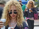 Gee, frizz! Juno Temple has a hair raising moment when gust of wind blows her blonde mane into a tangle