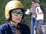 Golden dome: Minnie Driver wore a gold helmet on Tuesday for a motorcycle ride with her boyfriend in Malibu, California