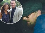 Leonardo DiCaprio tries to hide from photographers after the husband of model he was seen getting close to takes own life