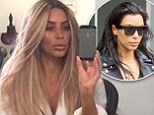 'It's baaaaack!' Kim Kardashian goes blonde again as she shares a selfie showing off her highlighted locks