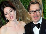Fourth time lucky: Gary Oldman and wife Alexandra in 2012. His films have grossed around £6billion - putting the likes of Leonardo DiCaprio or Brad Pitt in the shade
