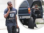 Drive slow homie! Kanye West is forced to make a giant leap as he struggles to get out of a jacked up monster truck