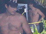 Father-to-be Ashton Kutcher goes shirtless on the LA set of Lenovo Yoga Tablet commercial