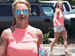 She's gone blooming Crazy! Britney Spears shows off toned pins in pale shorts as she shops for flowers in bra-flashing pink top