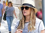 Wet hair, don't care: Drew Barrymore steps out in New York City with damp tresses... days after doing her make-up on the subway