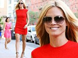 Red hot! Heidi Klum wows in sizzling red dress that showcases her toned pins and bare arms