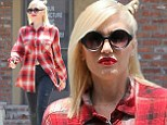 Gwen Stefani swamps her post-baby body in red plaid shirt but still manages to show some toned tummy after acupuncture visit