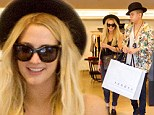 Ashlee Simpson and fiance Evan Ross go shopping in New York in matching hats on June 25