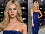 Nicola Peltz continues to steal the limelight as she dazzles in slinky strapless frock at Transformers premiere in New York