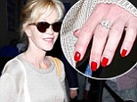 Melanie Griffith keeps her chin up as she lands at LAX with no wedding ring following reports of Antonio Banderas' dallianc