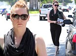 Must be all the yoga! Amy Adams shows off athletic physique in black leggings and snug tank top