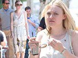 Summer chic: Dakota Fanning opted to wear a floral frock as she stepped out in Los Angeles Monday