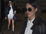 Baby, it's cold out! Nicole Trunfio braves winter chill and bares long legs in TINY pair of denim shorts as she jets into Sydney