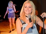 Pixie Lott shows off her slim legs in double denim dungarees during special charity performance for young students
