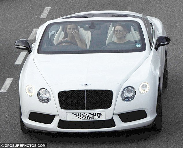 Nice wheels: After posting an unflattering photo of her cheating best friend on Twitter, Katie Price cheered herself up with a spin in her new Bentley on Wednesday
