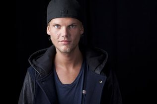 FILE - In this Aug. 30, 2013 file photo, Swedish DJ, remixer and record producer Avicii poses for a portrait, in New York. Many people who attended an electronic dance music show featuring Swedish disc jockey Avicii at the TD Garden arena on Wednesday June 25, 2014 showed up intoxicated and several were hospitalized, authorities said. The Emergency Medical Service took 22 people to the hospital, and a dozen more were under evaluation, EMS Deputy Superintendent Mike Bosse told the Boston Herald.