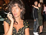 Paz de la Huerta displays a conservative side in black and yellow polka dot dress as she enjoys Paris with beau Qarim Brown