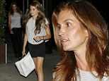 Cindy Crawford and her lookalike daughter Kaia wear matching ensembles for family meal at upscale Italian restaurant