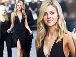 Nicola Peltz takes the plunge in low-cut split dress to promote Transformers movie... as Rosie Huntington-Whiteley brands her 'a star in the making'