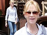 Happily single? Melanie Griffiths is full of smiles as she runs errands... after Sharon Stone denies romance with estranged husband Antonio Banderas