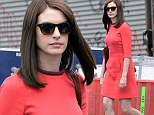 The mane attraction! Anne Hathaway covers up her cropped hair with long brunette wig on New York set of The Intern