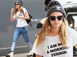 Cara Delevingne steps out in ¿I¿m Not A Morning Person¿ slogan top¿ following Twitter rant over Vogue magazine claims she slept through her interview