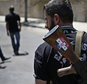 FILE - This Aug. 21, 2013 file photo shows a Syrian military soldier holding his AK-47 with a sticker of Syrian President Bashar Assad and Arabic that reads,...