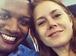 First class all the way: Amy Adams pictured with Ernest Owens, her seatmate in coach after she gave her first class ticket to a soldier on the same flight