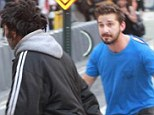 Crowds of baffled bystanders in Midtown Manhattan witnessed Shia LaBeouf racing through traffic in broad daylight on Thursday (pictured) after the man who didn't appear to know who he was. It seemed the actor wanted either a bag of McDonalds food or a baseball cap that the man had. He repeatedly said: 'It's me, Shia.' The 28-year-old former child star (inset) was released by police today after being escorted out of a Broadway theater for allegedly slapping actors, smoking inside and yelling obscenities later on Thursday night.