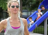 Sweaty betties: Gisele and sis hug it out after sweat-heavy spin class in Boston as she runs to park to spend family time with US footballer hubby Tom Brady