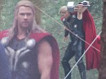 Hammering his point home! Chris Hemsworth shows off his muscular strength as he jumps into action on set of Avengers