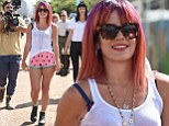 Lily Allen showcases her slim legs in tiny watermelon print shorts as she leads celebrity arrivals at Glastonbury