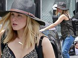 Kristen Bell reveals tiny baby bump as she enjoys a shopping trip on first outing since announcing pregnancy