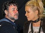 The very friendly exes! Russell Crowe and his ex wife Danielle Spencer are reunited as they jet into Los Angeles together with their two sons