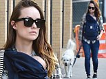 Her two babies! Olivia Wilde cradles bundle of joy Otis in sling while taking furry friend Paco for a walk