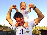 Like father, like son! Josh Duhamel shared a snap on Thursday carrying his son on his strong shoulders and holding up the tot's hands, wearing matching jerseys for the World Cup