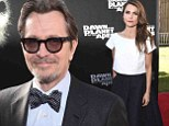 Gary Oldman puts on a brave face following THAT Playboy interview... as he joins Keri Russell at Planet Of The Apes premiere