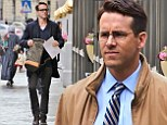 Ryan Reynolds looks dapper in brown jacket and navy trousers as he films Woman In Gold with Dame Helen Mirren