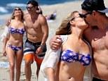 LeAnn Rimes hits the beach in sexy bikini and shares kiss with husband Eddie Cibrian (but where did his six pack go?)