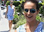 Camilla Belle is a vision in exotic blue wrap dress with gladiator sandals as she grabs lunch with a friend